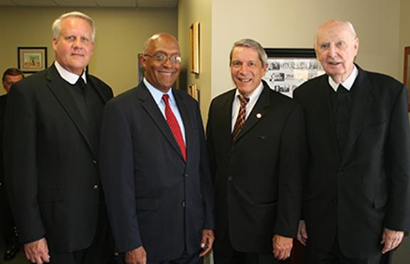 (L-R) CBHS President Bro. Chris Englert, FSC, Jesse Turner Jr., CBU President Dr. John Smarelli, and Bro. Terence McLaughlin, FSC