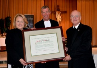 (L-R) Dr. Stephany Schlachter, Bro. Larry Schatz, FSC, Visitor of Midwest District, and Bro. James Gaffney, FSC, President of Lewis University