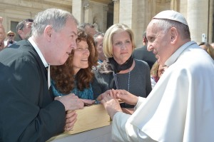 Brother William Mann, president of Saint Mary's University of Minnesota, along with Mary Burrichter, center, and Sandra Simon, right, Saint Mary's University trustees, presented the Signum Fidei Award to Pope Francis April 15 in Rome. Courtesy L'Osservatore Romano