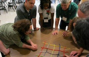 Participants work together to make a yarn net.