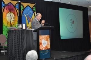Keynote speaker John L. McKnight addresses participants on Friday morning.