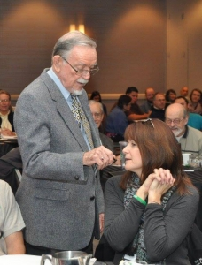 John L. McKnight engages with participants during his keynote address on Friday