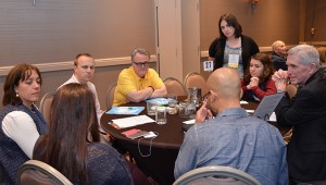 Sarah Laitinen, director of program for the Office of Lasallian Education, listens in on casa discussions.