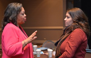 Ellie Cash, right, talks with keynote presenter, the Honorable Susan D. Page, after the address.